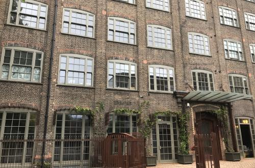 Private, garden level office space available in a stunning old piano factory renovated New York loft style!